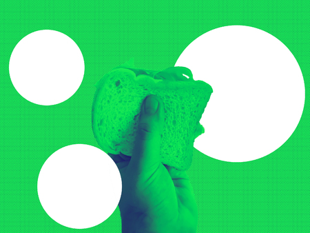 Male hand holding a baked ham sandwich. Junk Food concept. Green duotone effect 写真素材