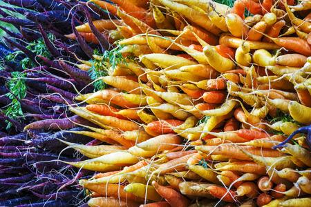 Bunch of organic carrots on a stall of an urban farmer market