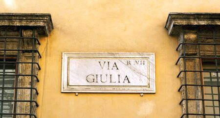 The indication of the Via Giulia address in an old marble sign in Rome.