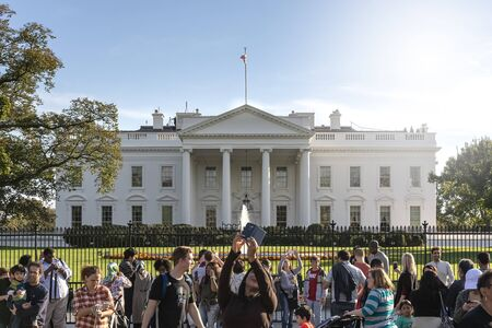 Washington D.C. USA, October 2016: tourists taking photos in front of the White House on a sunny day. Tourism and travel