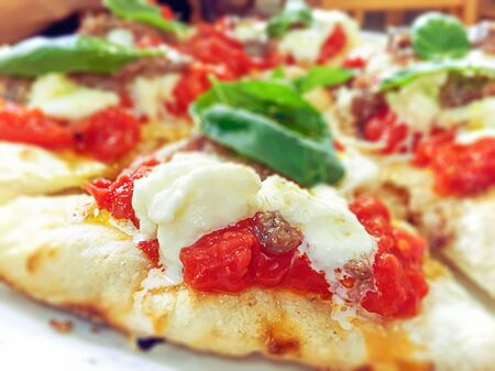 close-up view of a margherita pizza with fresh tomatoes, mozzarella cheese and basil leaves. Typical Neapolitan and Italian recipe Stock fotó