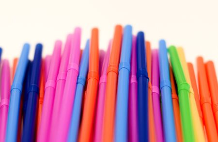 a group of colored plastic cocktail straws. Plastic and non-recyclable materials. Pollution and environmental issues Imagens