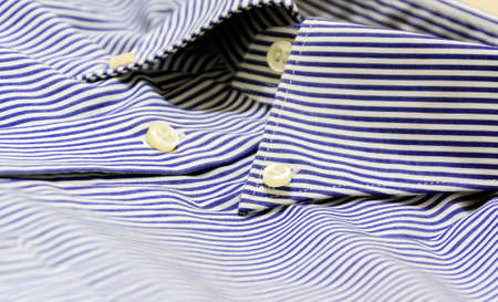 A blue striped shirt with a button down collar. Formal wear for events or work and business meetings 免版税图像