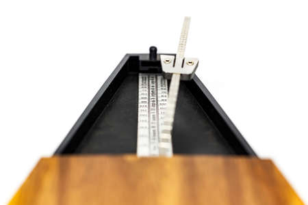 Detail of the pendulum of a classic metronome. Rhythm measurement tool. Mechanical movement without electricity Standard-Bild