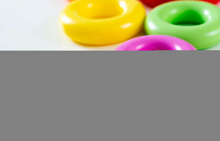 colorful plastic rings isolated on a white background. Children's toys. Same size for each ring