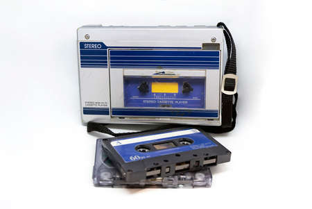 Old portable stereo audio tape cassette player isolated on a white background. Obsolete technology. 80s. Listening to music.