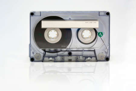 Transparent 90 minute audio cassette with blank adhesive label. Side A of the cassette. Magnetic tape and audio reproduction from the 70s and 80s. Vintage object