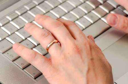 young caucasian woman typing on laptop keyboard. Working from home. Smart working concept Stock Photo