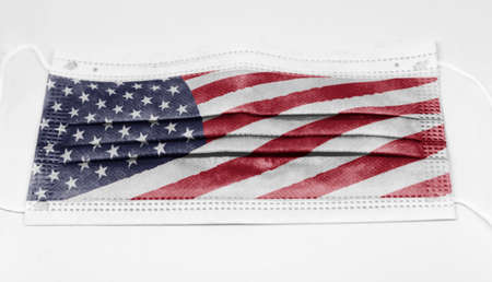 surgical mask with the USA national flag printed. Pandemic covid-19 and preventive measures to counter the spread of the virus Stock Photo