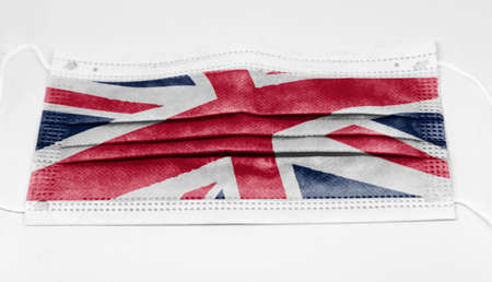 surgical mask with the national flag of England printed. Pandemic covid-19 and preventive measures to counter the spread of the virus