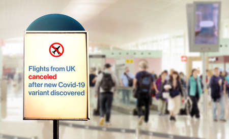 a sign inside an airport warns of the cancellation of flights form UK after new Covid-19 variant discover. Airport security measures and travel restrictions. Corona virus pandemic Stock Photo