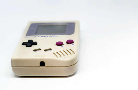 Rome, Italy, December 23, 2020: The Gameboy portable video game console from Nintendo isolated on a white background. Vintage video game console from the 90s