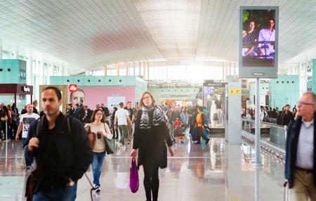 Barcelona, Spain, April 2019: people walking along the international departures corridor of El Prat airport in Barcelona, Spain Editorial