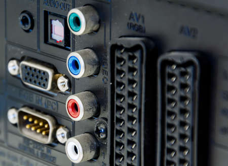 Rear panel of a television with sockets for audio and video signal, scart connections and for rgb video input for the monitor. Technology and connections between devices