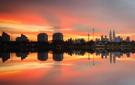 A reflection of a sunset in the city