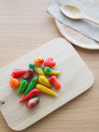delectable: Delectable imitation fruits on woodedn table, Thai traditional dessert