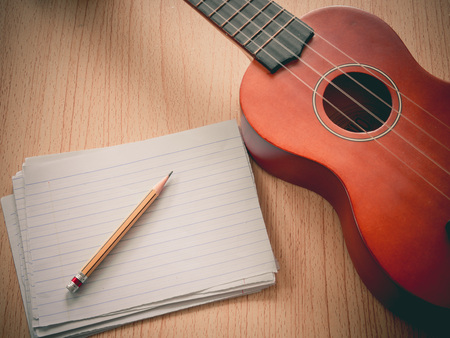Paper note with Ukulele, Selective focus on pencil sharpness, Concept for music writing photo