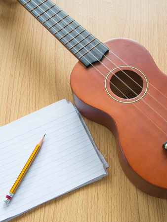 sharpness: Paper note with Ukulele, Selective focus on pencil sharpness, Concept for music writing