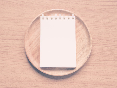commentator: Paper note on wood dish , Concept for Menu Creation or Restaurant Commentator,  Filter style process.