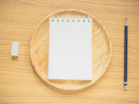 commentator: Paper note on wood dish with pencil and eraser, Concept for Menu Creation or Restaurant Commentator, Filter process. Stock Photo