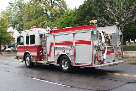 Fire Truck rushes to the scene of a house fire Stock Photo