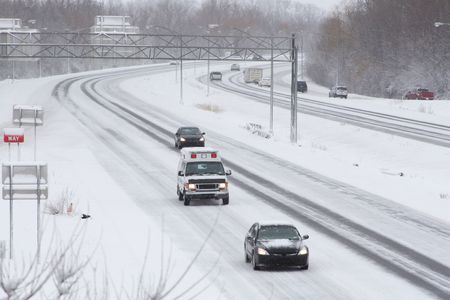 squall: Traffic on expressway during winter snow storm