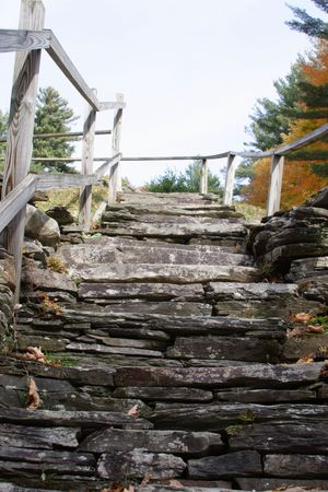 hand rails: Stone Stairway with wooden hand rails