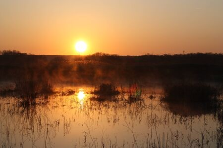 A sunrise over the lake Фото со стока