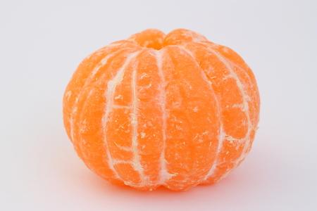 Peeled mandarin on a white