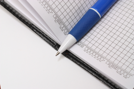 notation: Notepad with pen on a white Stock Photo