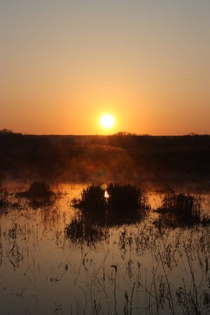 A sunrise over the lake Фото со стока - 46527189