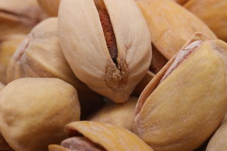 depicted: Several pistachios depicted close-up