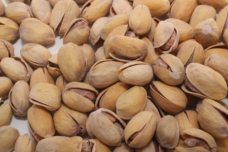 Several pistachios depicted close-up