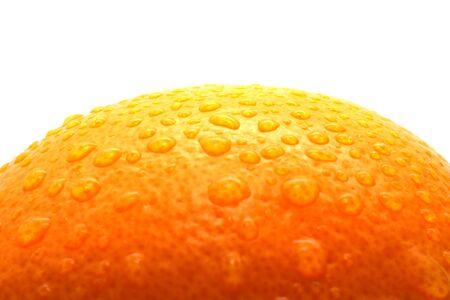Water drops on large orange Фото со стока