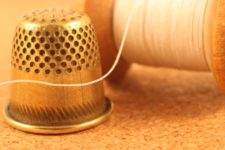 Old spool of thread and thimble
