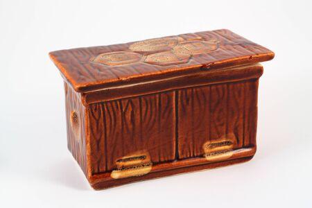 Brown ceramic casket on a white Фото со стока