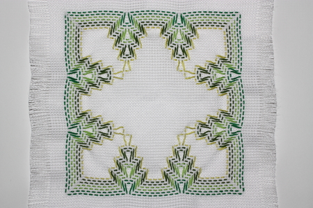Embroidery with a pattern of green colors Фото со стока