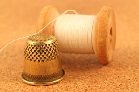 spool: Old spool of thread and thimble