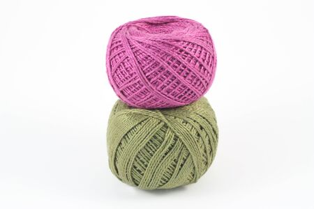 weave ball: Two green and purple balls of yarn on white Stock Photo