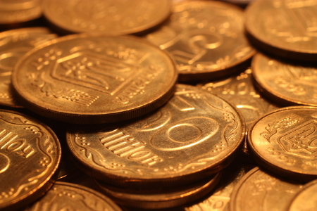 Pile of yellow coins closeup