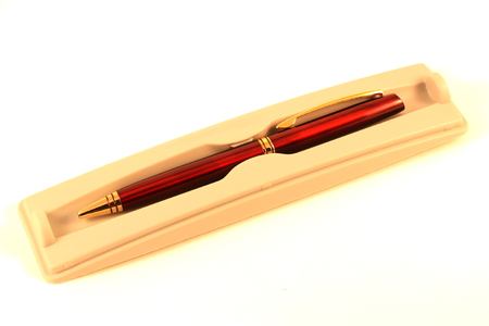 Ballpoint pen in a case isolated on white Фото со стока