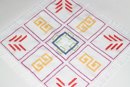 Embroidery with multi-colored pattern