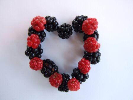 berries; heart shaped fresh berries isolated on white Stock Photo