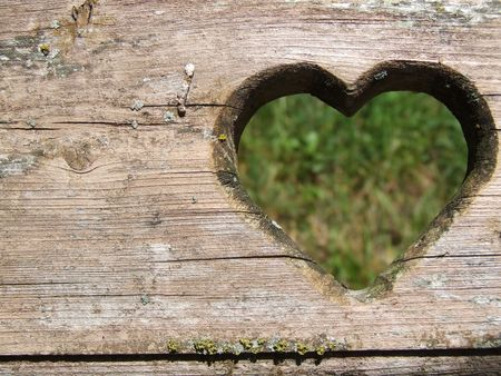 sweet heart: Heart carved in wood Stock Photo