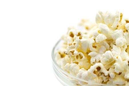 Popcorn in a glass bowl isolated on white background photo
