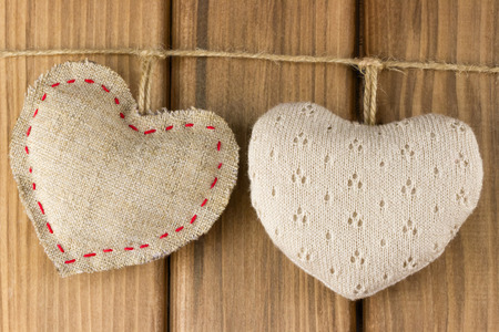 Love story concept. Two soft hearts on wooden background Standard-Bild