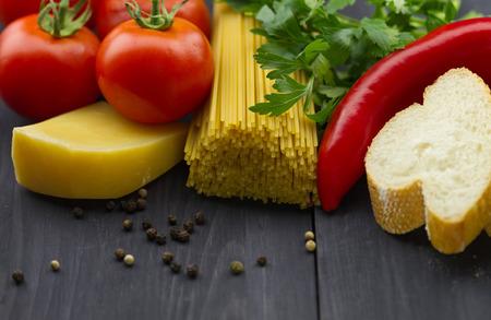 Italian vegetables and spices on dark wooden background Standard-Bild