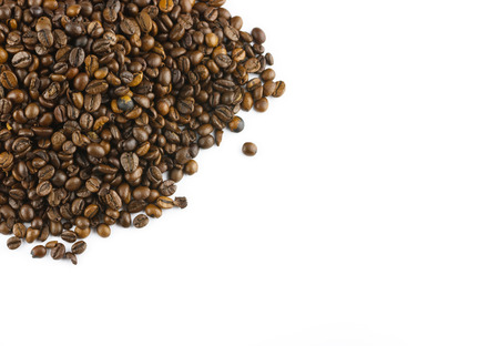 Top view of roasted coffee beans isolated on white background