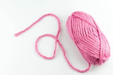 Top view of pink woolen threads on white background Standard-Bild