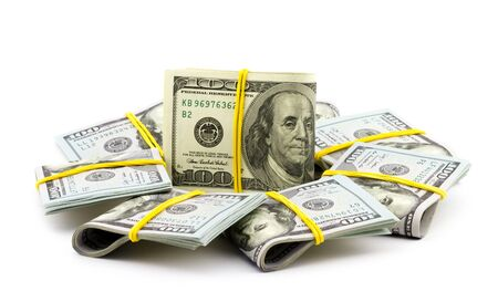 Bundle of dollar bills isolated on white background